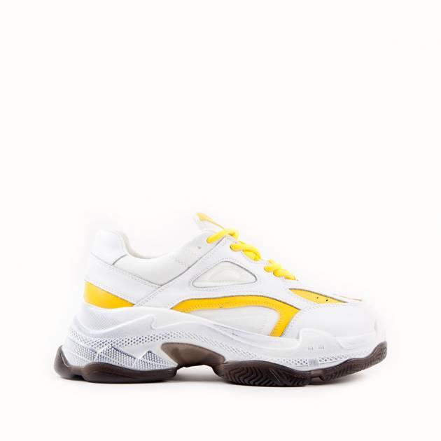 Кроссовки из кожи белого цвета с жёлтыми элементами