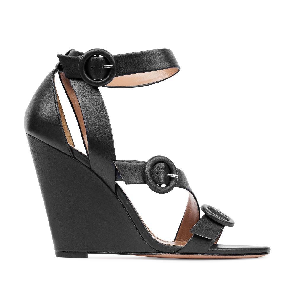 Босоножки из кожи черного цвета с ремешками на танкеткеТуфли женские<br><br>Материал верха: Кожа<br>Материал подкладки: Кожа<br>Материал подошвы:Кожа<br>Цвет: Черный<br>Высота каблука: 10 см<br>Дизайн: Италия<br>Страна производства: Китай<br><br>Высота каблука: 10 см<br>Материал верха: Кожа<br>Материал подошвы: Кожа<br>Материал подкладки: Кожа<br>Цвет: Черный<br>Вес кг: 1.00000000<br>Размер обуви: 38