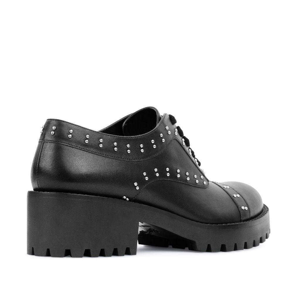 Женские ботинки CorsoComo (Корсо Комо) Кожаные ботинки черного цвета с заклепками