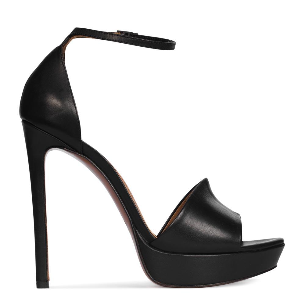 Босоножки из кожи черного цвета на высоком каблуке с ремешкомТуфли женские<br><br>Материал верха: Кожа<br>Материал подкладки: Кожа<br>Материал подошвы: Кожа<br>Цвет: Черный<br>Высота каблука: 13 см<br>Дизайн: Италия<br>Страна производства: Китай<br><br>Обратите внимание: модель, представленная в последнем<br>размере, может иметь незначительные изъяны (неглубокие царапины,<br>потертости, легкое выцветание, повреждения упаковки).<br><br>Высота каблука: 13 см<br>Материал верха: Кожа<br>Материал подкладки: Кожа<br>Цвет: Черный<br>Пол: Женский<br>Вес кг: 1.00000000<br>Размер обуви: 39